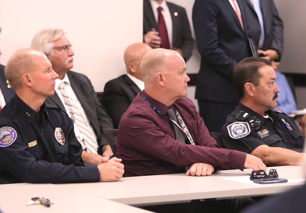 Mesquite Fire Department Deputy Chief Scott Taylor, left, Clark County Fire Chief Greg Cassell, and North Las Vegas Police Assistant Chief Dave Noahr listen to U.S. Attorney General Jeff Sessions  ...