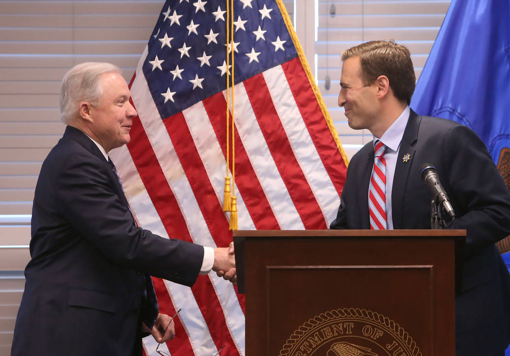 U.S. Attorney General Jeff Sessions, left, introduced by Nevada Attorney General Adam Laxalt on Wednesday, July 11, 2017, at U.S. Attorney's Office, in Las Vegas. Sessions spoke to federal, state  ...