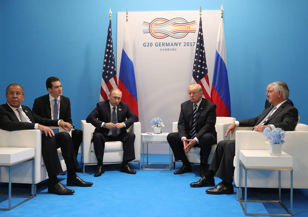 President Donald Trump, second right, and Russian President Vladimir Putin, third left, attend talks during the G20 summit in Hamburg Germany, Friday July 7, 2017. Russian Foreign Minister Sergey  ...