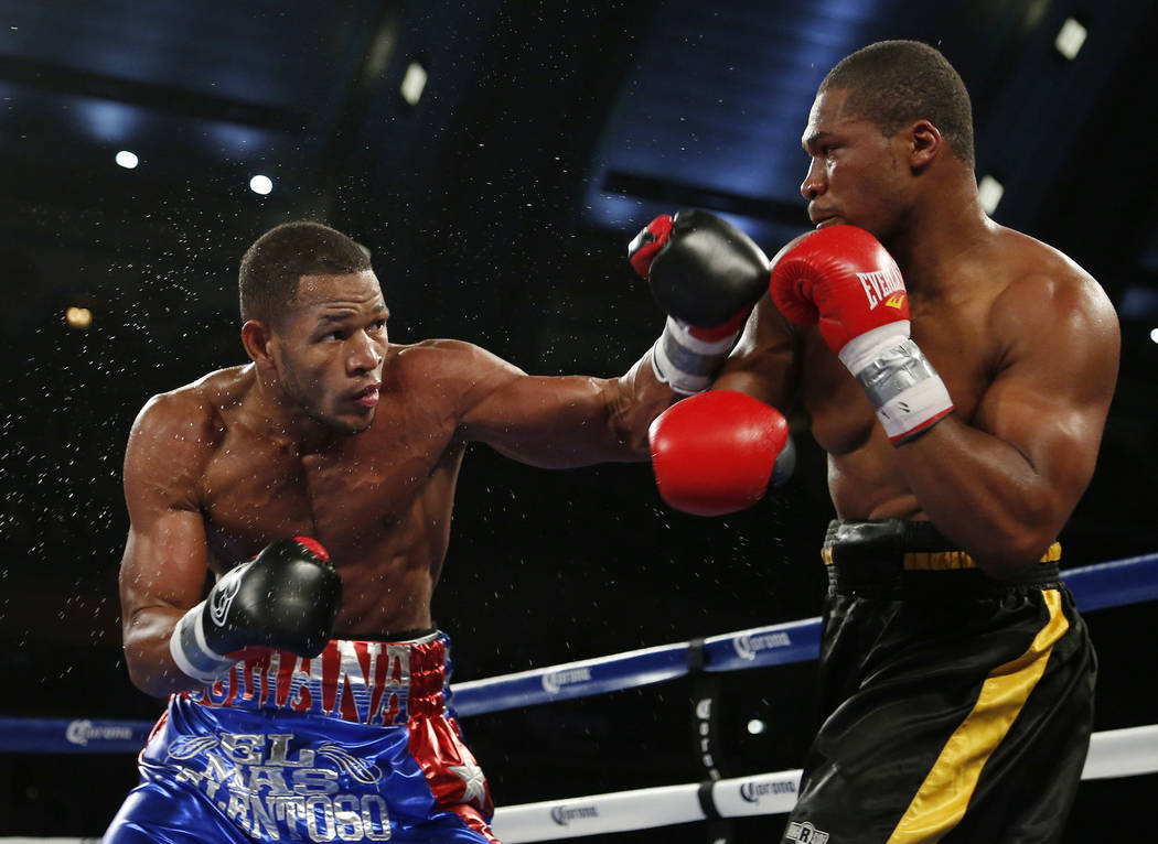 Sullivan Barrera, left, throws a left at Rowland Bryant during the third round of a light heavyweight boxing bout in Atlantic City, N.J., on Saturday, Nov. 8, 2014. Barrera won when the first was  ...
