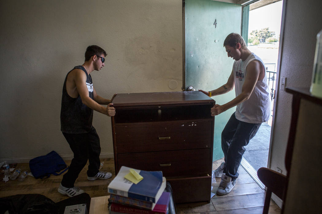 Michael Callaghan, 18, right, and Jeremy Wells, 19, move a dresser at the Shannon West Center for Homeless Youth on Wednesday, July 12, 2017. The center will move into a new location on Flamingo R ...