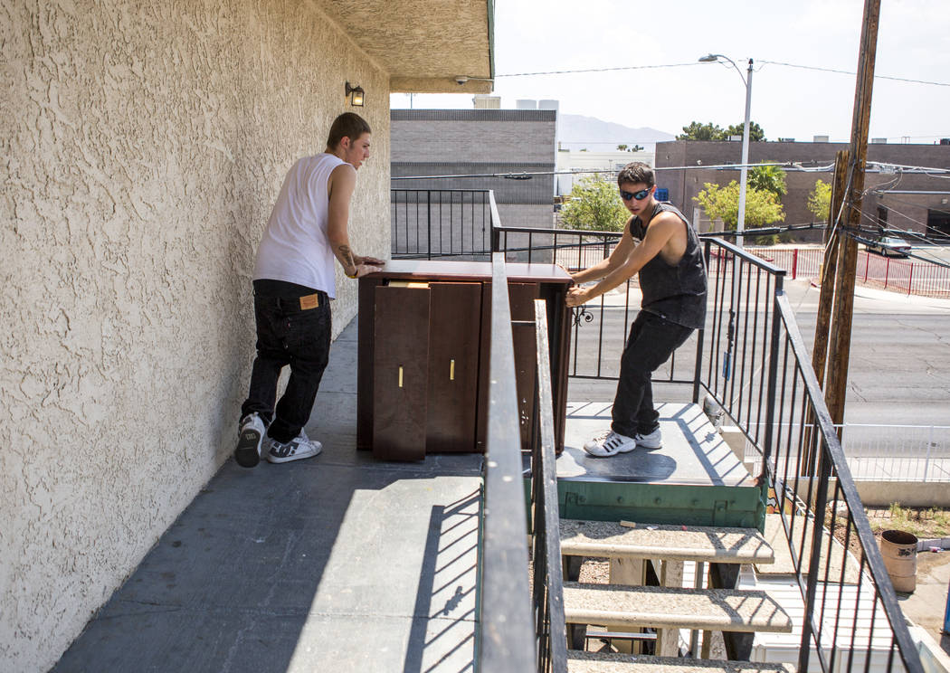Michael Callaghan, 18, left, and Jeremy Wells, 19, move a dresser at the Shannon West Center for Homeless Youth on Wednesday, July 12, 2017. The center will move into a new location on Flamingo Ro ...
