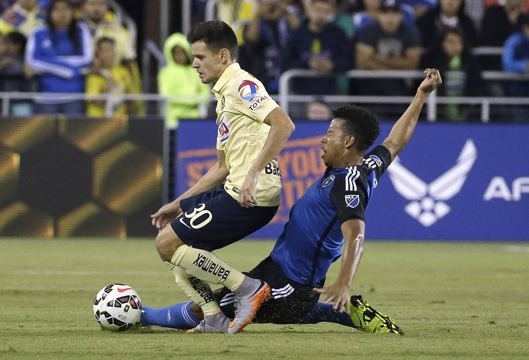 San Jose Earthquakes midfielder Matheus Silva, right, challenges Club America forward Alejandro Diaz (30) for the ball during the second half of an International Champions Cup soccer match in San  ...