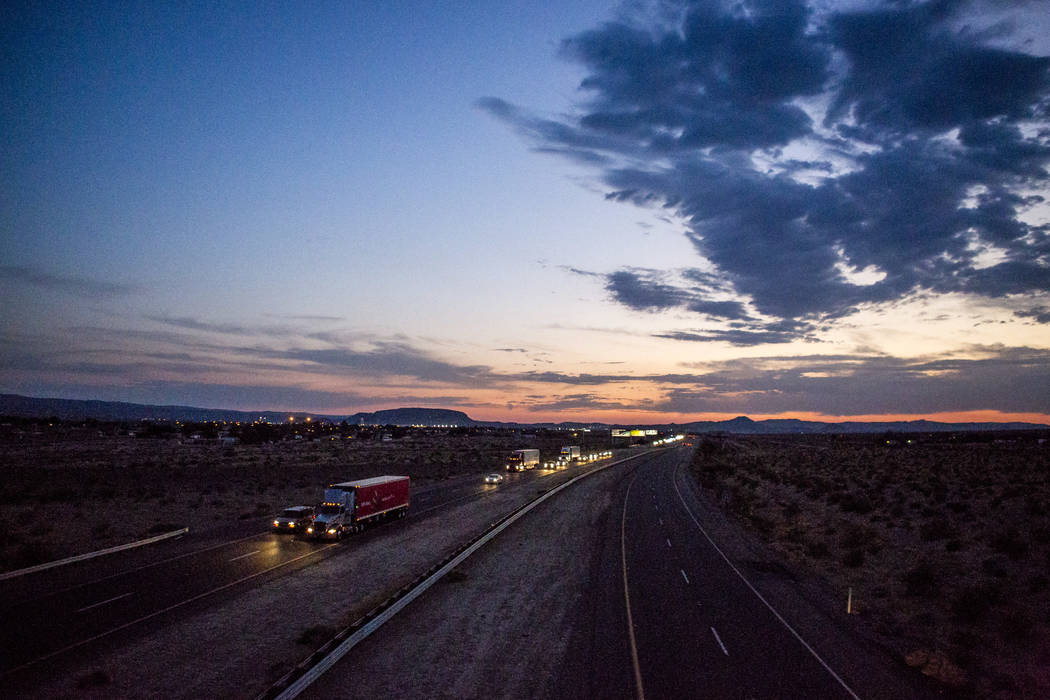 Cars pass by on Interstate 15 at sunset near Yermo, Calif. on Saturday, July 8, 2017.  Patrick Connolly Las Vegas Review-Journal @PConnPie