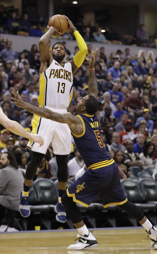Indiana Pacers' Paul George shoots against Cleveland Cavaliers' JR Smith during the second half in Game 4 of a first-round NBA basketball playoff series, Sunday, April 23, 2017, in Indianapolis. C ...