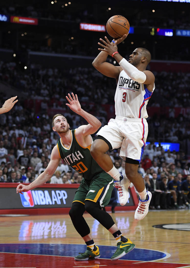 Los Angeles Clippers guard Chris Paul, right, shoots as Utah Jazz forward Gordon Hayward defends during the second half in Game 5 of an NBA basketball first-round playoff series, Tuesday, April 25 ...