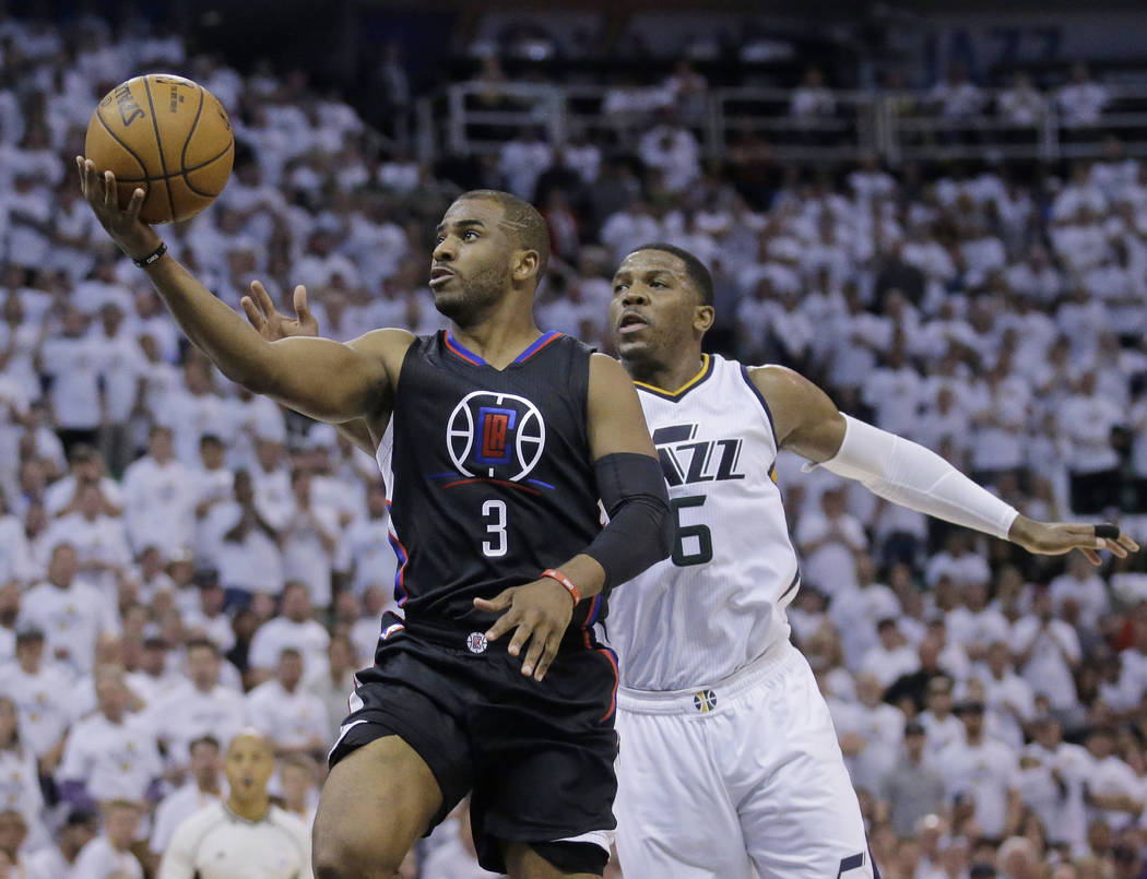 Los Angeles Clippers guard Chris Paul (3) lays the ball up as Utah Jazz forward Joe Johnson (6) defends during the first half in Game 4 of an NBA basketball first-round playoff series Sunday, Apri ...