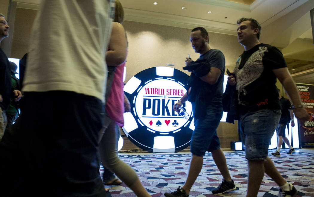 People head to different rooms for the beginning of the World Series of Poker $10,000 no-limit hold 'em Main Event at the Rio Convention Center in Las Vegas, Monday, July 10, 2017. Elizabeth Bruml ...