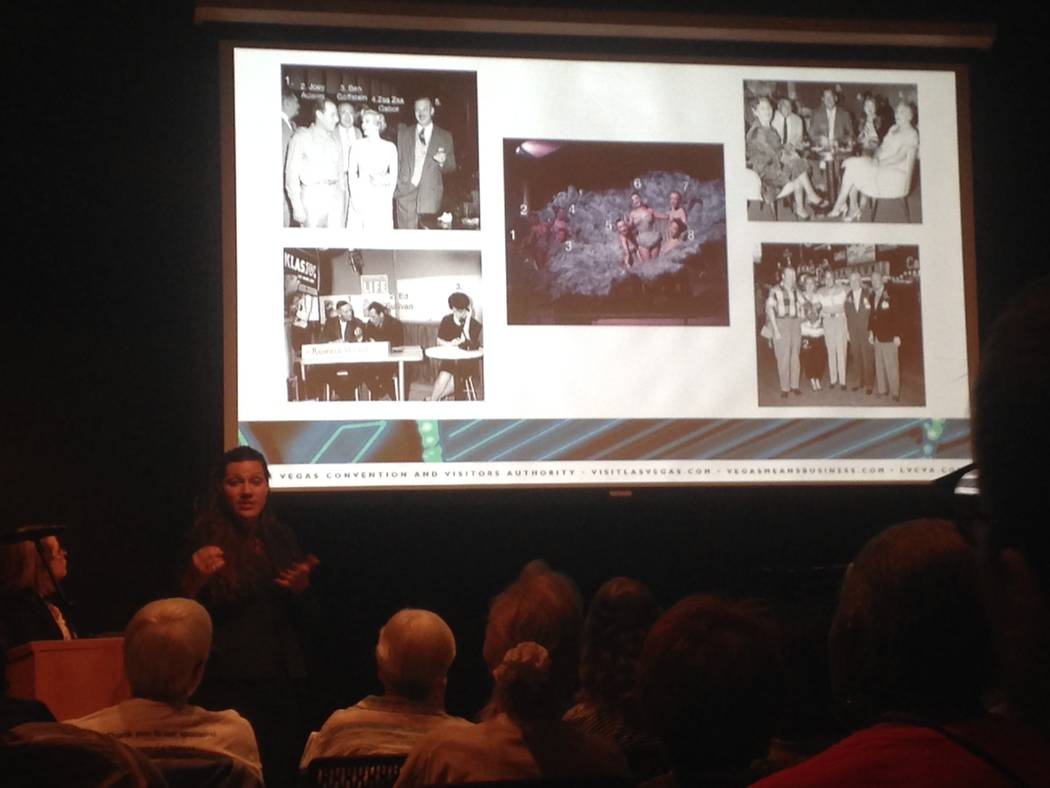 Kelli Luchs, and archivist with the Las Vegas News Bureau, shows a crowd of about 50 examples of historical photographs where people need to be identified at the Clark County Library on July 6, 20 ...