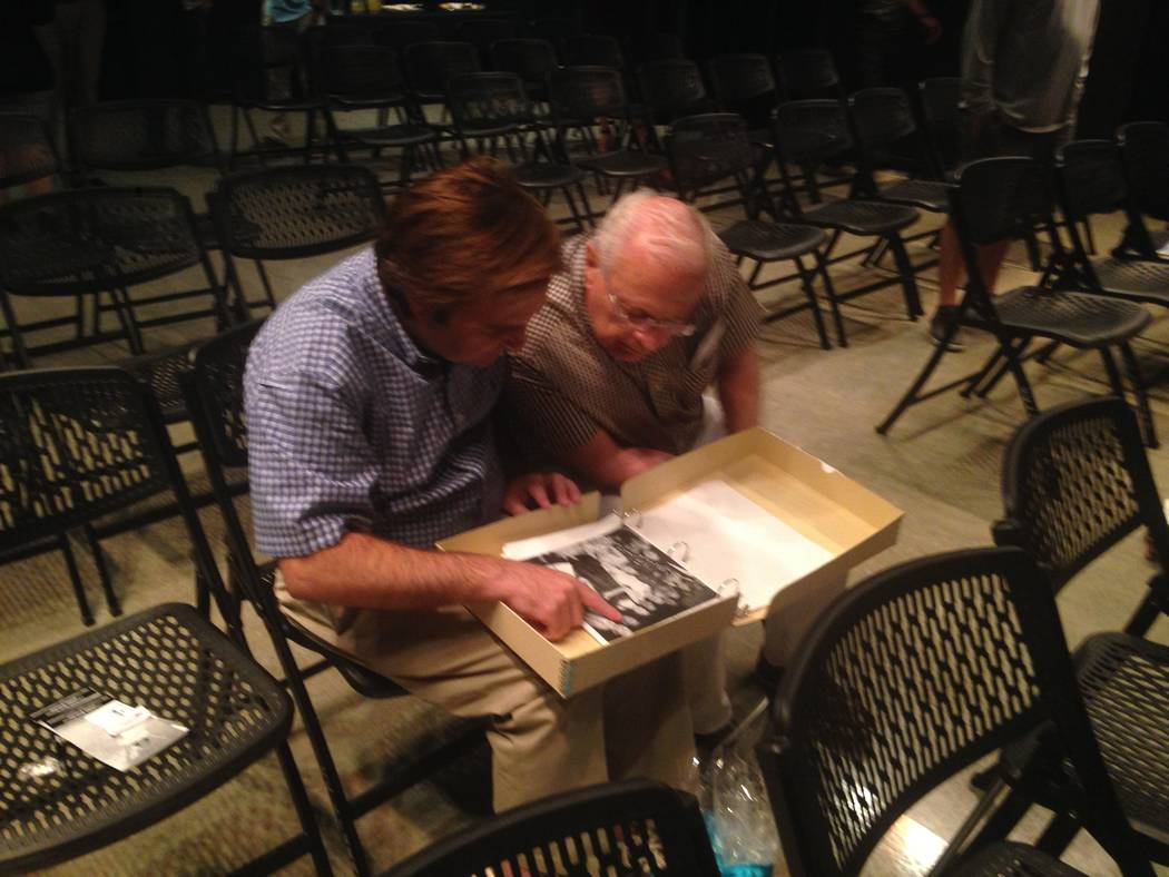 Dan Tuntland and Tito Tiberti flip through copies of old photographs during a presentation from the Las Vegas News Bureau and the Nevada State Museum Las Vegas at the Clark County Library on July  ...