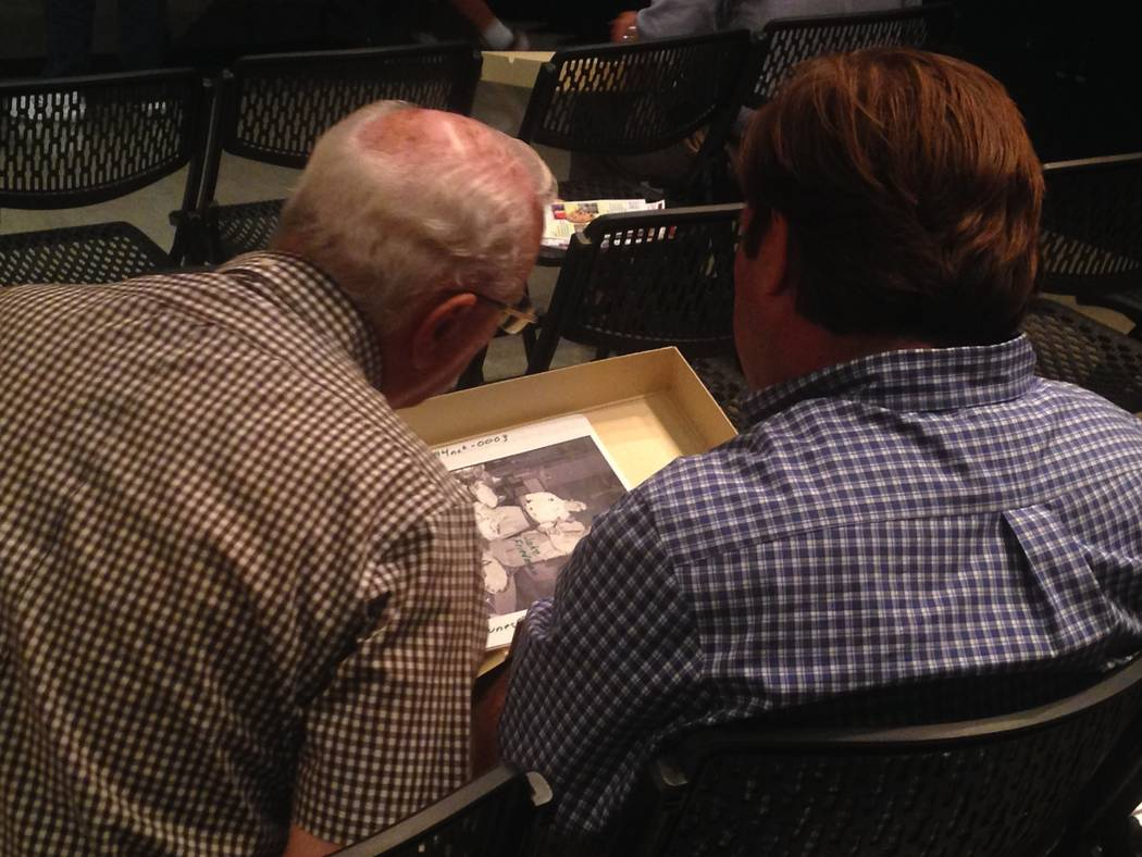 Tito Tiberti and Dan Tuntland flip through copies of old photographs during a presentation from the Las Vegas News Bureau and the Nevada State Museum Las Vegas at the Clark County Library on July  ...