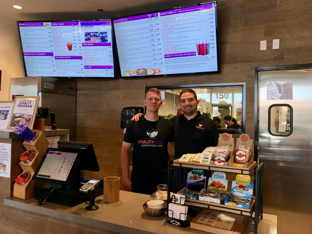 Charlie Belcher, left, and Antonio Mesquita, right, opened the first Vitality Bowls franchise in Las Vegas in April. (Madelyn Reese/View) @MadelynGReese