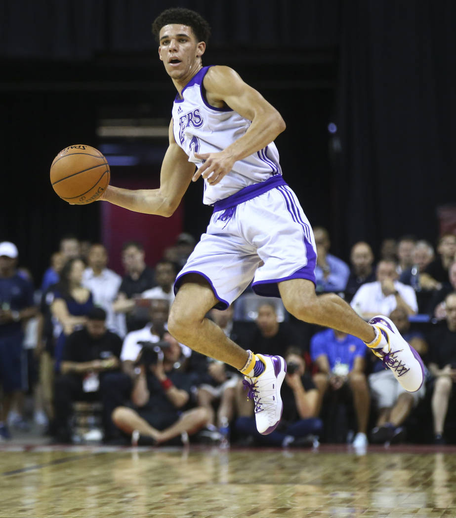 Los Angeles LakersՠLonzo Ball passes the ball during a basketball game against the Los Angeles Clippers at the NBA Summer League at the Thomas & Mack Center in Las Vegas on Friday, July  ...