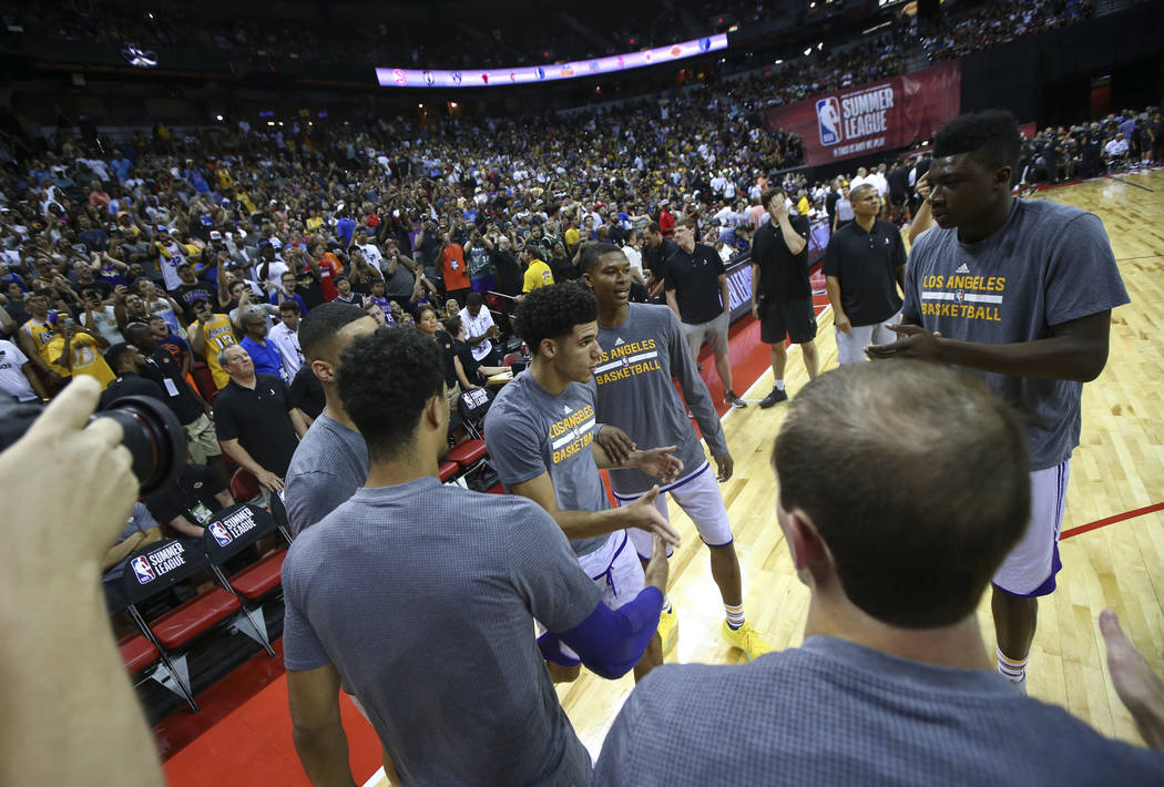 Los Angeles LakersՠLonzo Ball, center left, is introduced at the start of a basketball game against the Los Angeles Clippers at the NBA Summer League at the Thomas & Mack Center in Las V ...