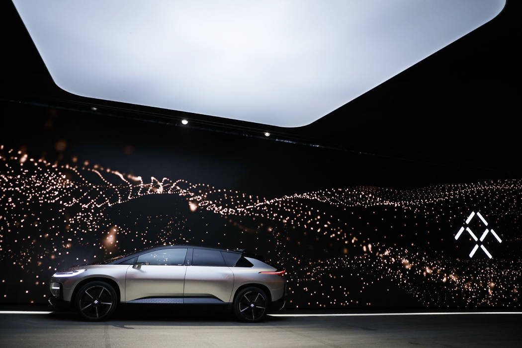 FILE--In this Jan. 3, 2017, file photo, Faraday Future's FF 91 electric car is unveiled during a news conference at CES International in Las Vegas. A contractor is suing upstart electric vehicle c ...