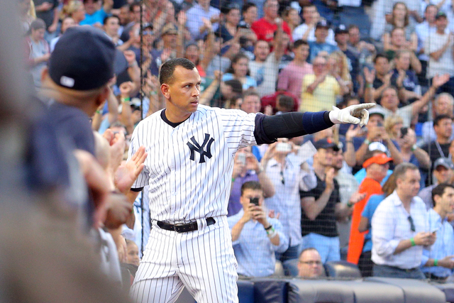 New York Yankee Alex Rodriguez takes a curtain call after hitting a solo home run, the 3000th hit of his career, on June 19, 2015, at Yankee Stadium. (Brad Penner-USA TODAY Sports)