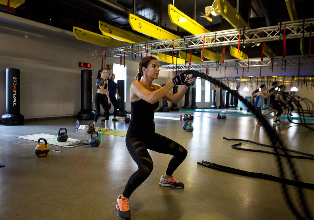 Jennifer Lee works out using battle ropes at TruFusion on Eastern Avenue in Las Vegas, Tuesday, July 10, 2017.(Elizabeth Brumley/Las Vegas Review-Journal)