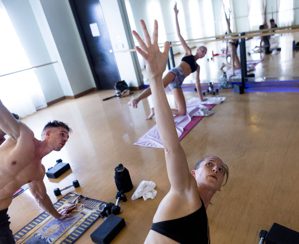 Taylor Moats, left, and Sara Larimore participate in a Tru Hot Pilates class at TruFusion on Eastern Avenue in Las Vegas, Tuesday, July 10, 2017. (Elizabeth Brumley/Las Vegas Review-Journal)