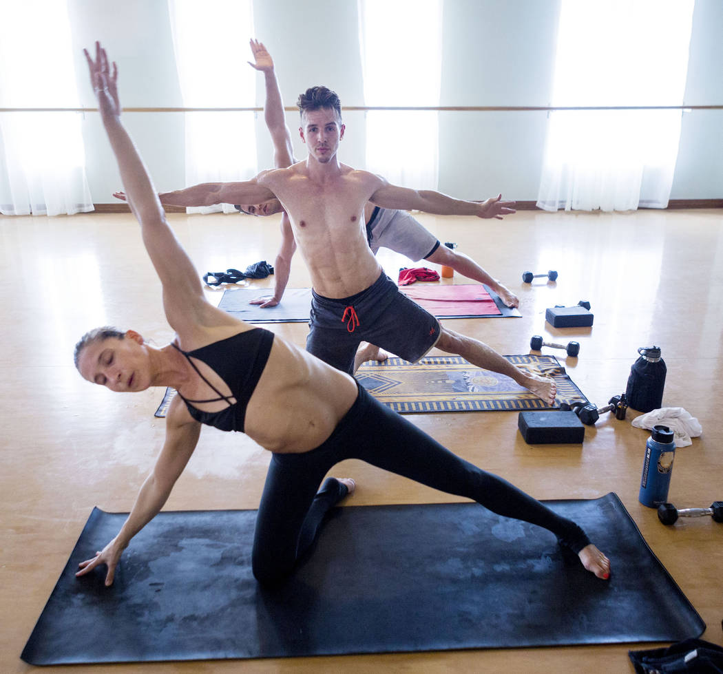 Sara Larimore and Taylor Moats participate in a Tru Hot Pilates class at TruFusion on Eastern Avenue in Las Vegas, Tuesday, July 10, 2017. (Elizabeth Brumley/Las Vegas Review-Journal)