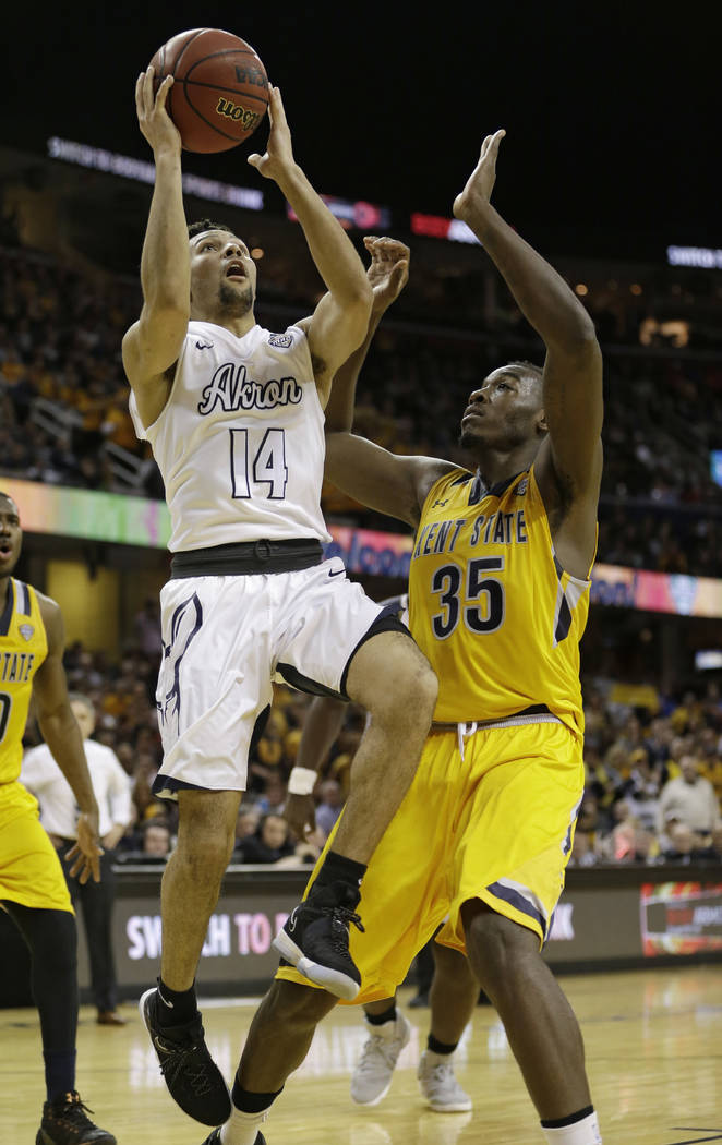 Akron's Noah Robotham (14) shoots against Kent State's Jimmy Hall during the second half of an NCAA college basketball championship game of the Mid-American Conference tournament, Saturday, March  ...