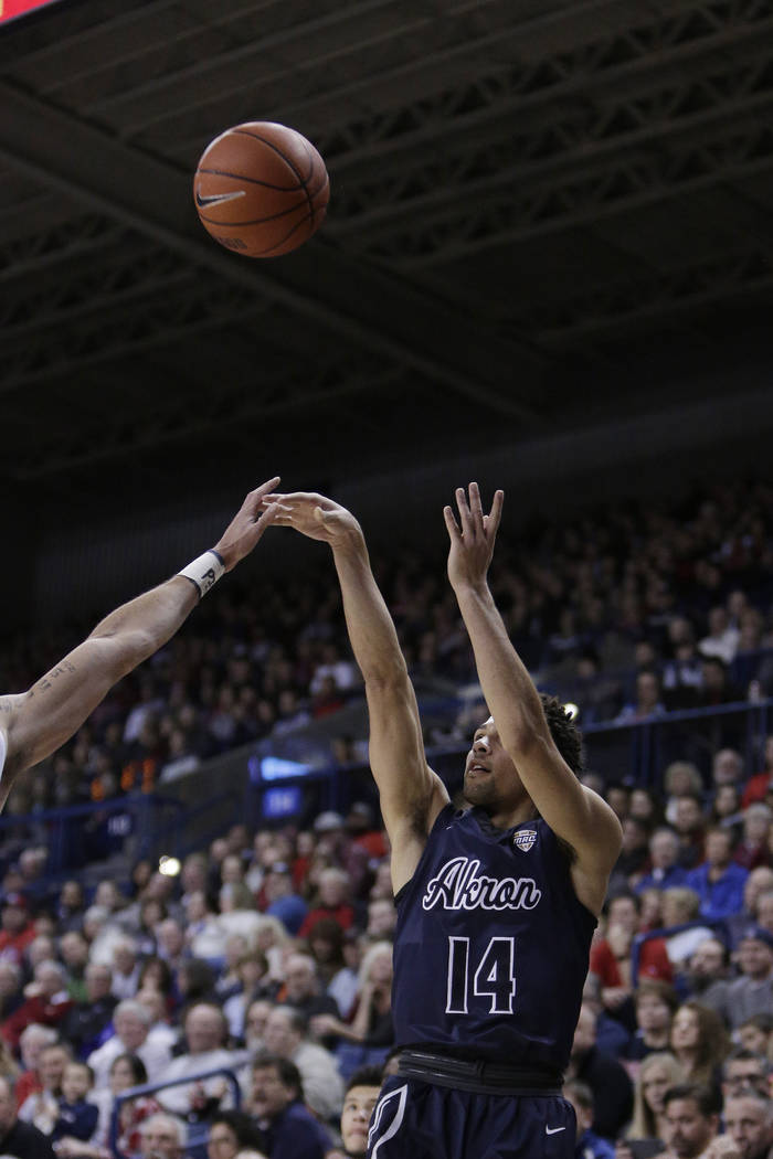 Akron guard Noah Robotham (14) shoots during the second half of an NCAA college basketball game against Gonzaga in Spokane, Wash., Saturday, Dec. 10, 2016. (AP Photo/Young Kwak)