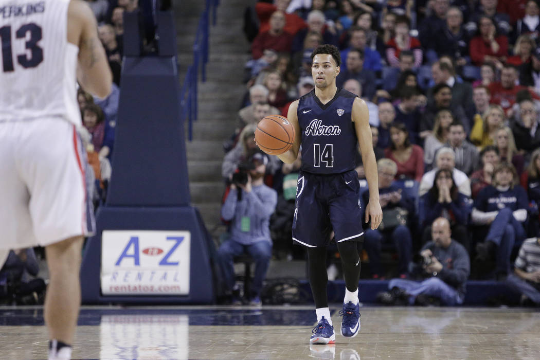 Akron guard Noah Robotham (14) dribbles the ball during the second half of an NCAA college basketball game against Gonzaga in Spokane, Wash., Saturday, Dec. 10, 2016. (AP Photo/Young Kwak)