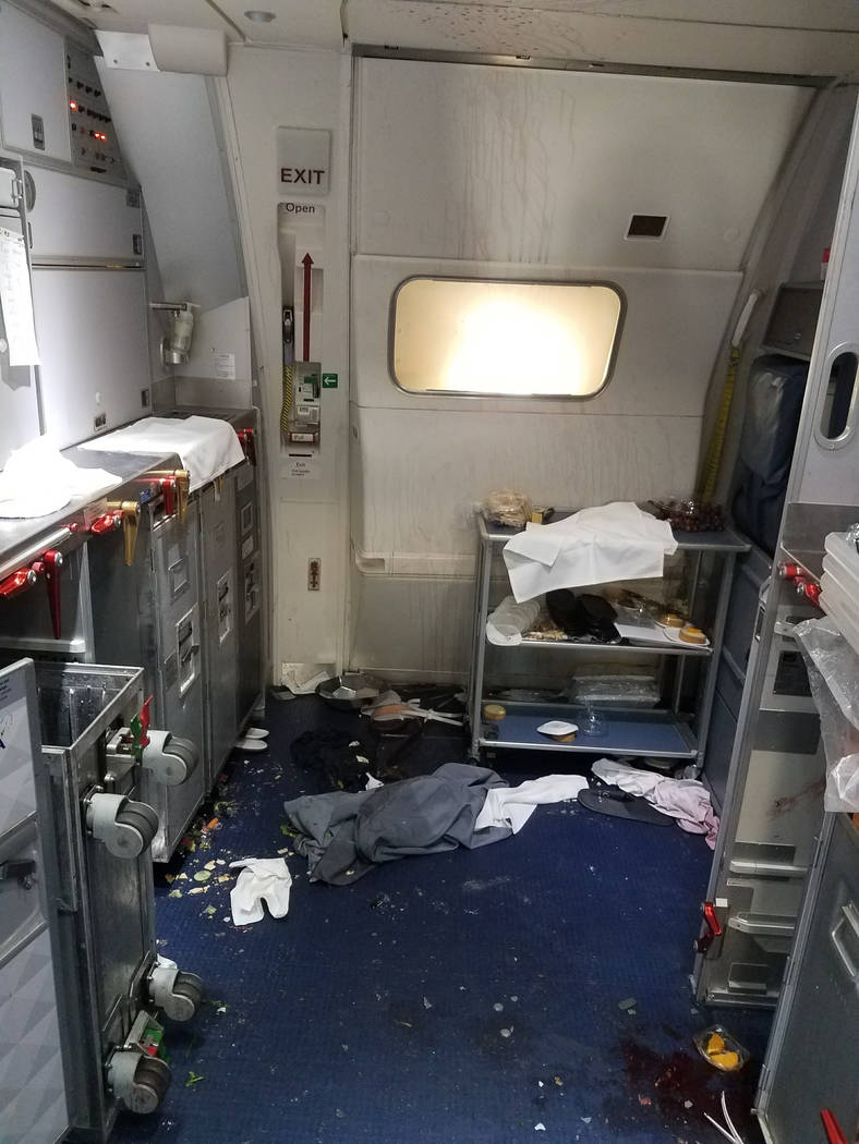 This Friday, July 7, 2017 photo taken the FBI and released via the U.S. Attorney's Office in Seattle shows the aftermath of a cabin on Delta Flight 129 from Seattle to Beijing, after authorities s ...