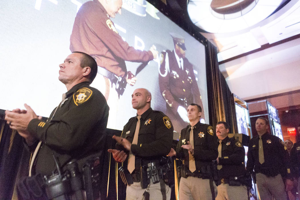Officers prepare to go on stage to be honored with the Medal of Valor during the annual Best of the Badge gala at  Red Rock Resort in Las Vegas, Friday, July 7, 2017. Elizabeth Brumley Las Vegas R ...