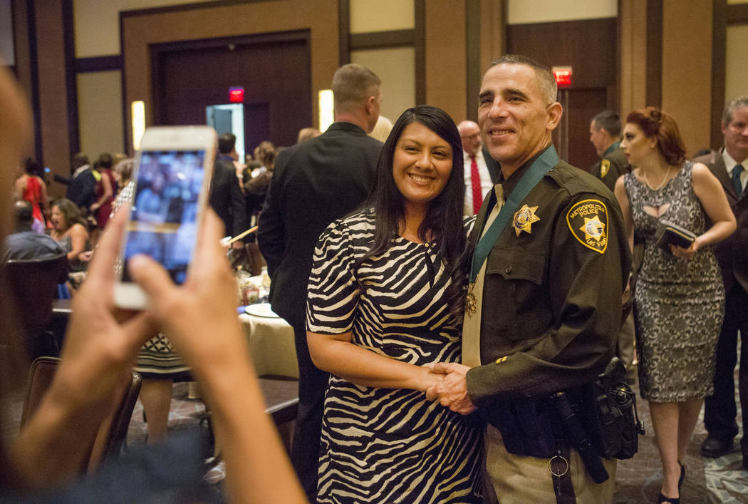 Jacqueline Vaughan and officer Terrence Vaughan take a photograph after Terrence Vaughan was honored at the Metropolitan Police Department's Best of the Badge gala at the Red Rock Resort in Las Ve ...