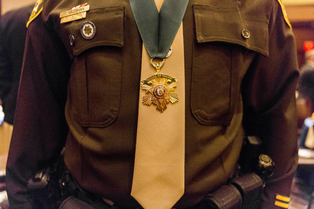 Officer Vaughan wears his Medal of Valor at the Metropolitan Police Department's Best of the Badge gala at the Red Rock Resort in Las Vegas, Friday, July 7, 2017. Elizabeth Brumley Las Vegas Revie ...