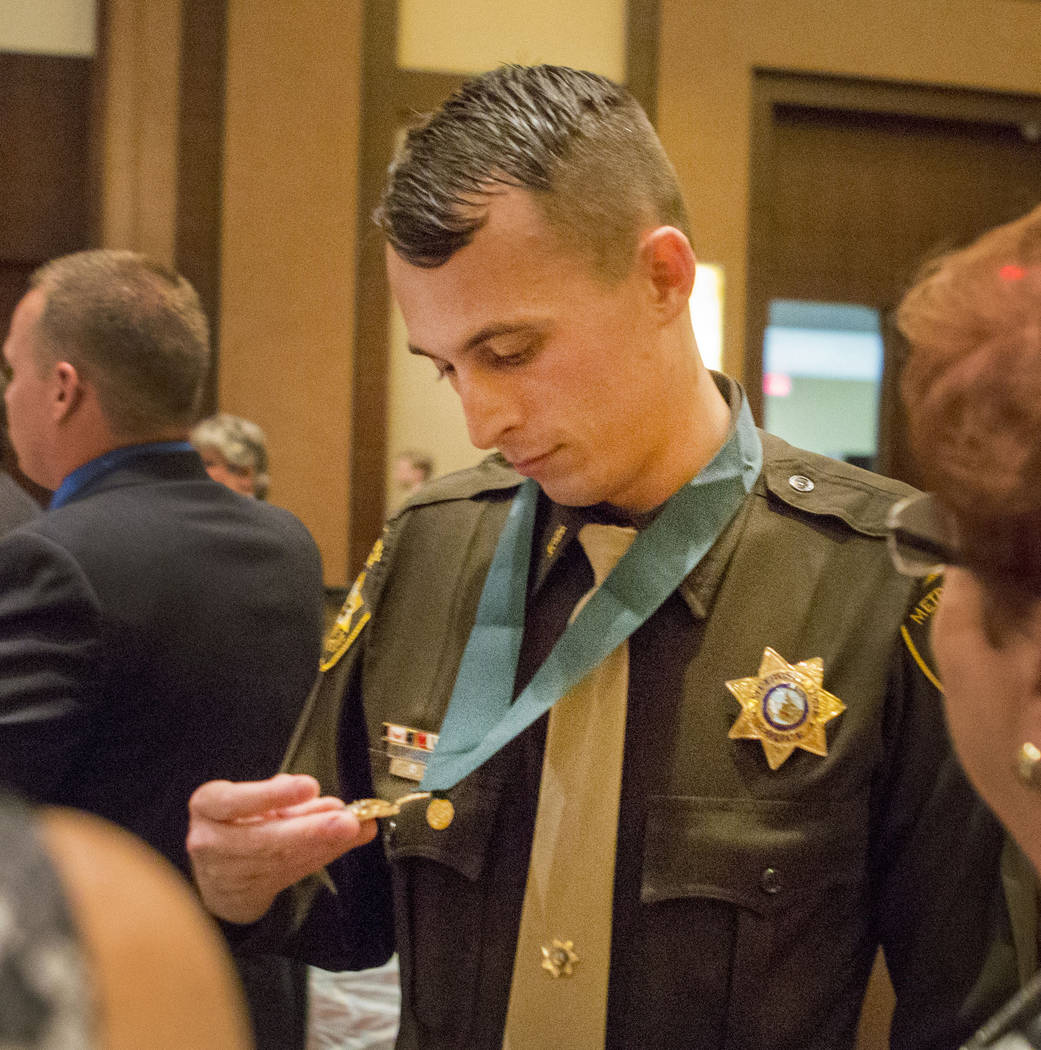 Officer Thomas Keller looks at his Medal of Valor presented to him at the Metropolitan Police Department's Best of the Badge gala at the Red Rock Resort in Las Vegas, Friday, July 7, 2017. Elizabe ...