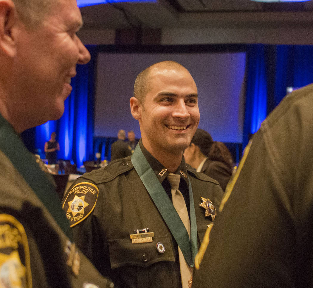 Sgt. Steve Reese talks during the Annual Sheriff Gala after receiving a Unit Medal of Valor during the Metropolitan Police Department's Best of the Badge gala at Red Rock Resort in Las Vegas, Frid ...