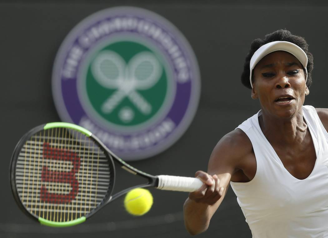 Venus Williams of the United States returns to Japan's Naomi Osaka during their Women's Singles Match on day five at the Wimbledon Tennis Championships in London Friday, July 7, 2017. (AP Photo/Ki ...