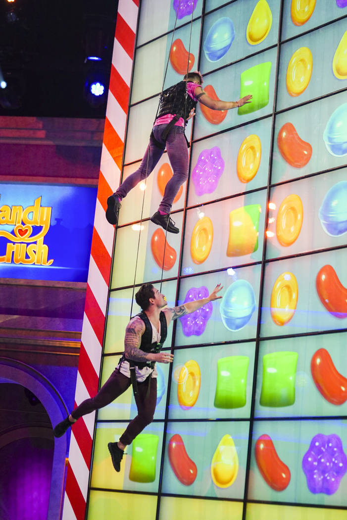 "Former ""Big Brother"" contestants Frankie Grande and Caleb Reynolds compete in the new game show ""Candy Crush,"" premiering Sunday, July 9. (Sonja Flemming/CBS via AP)"