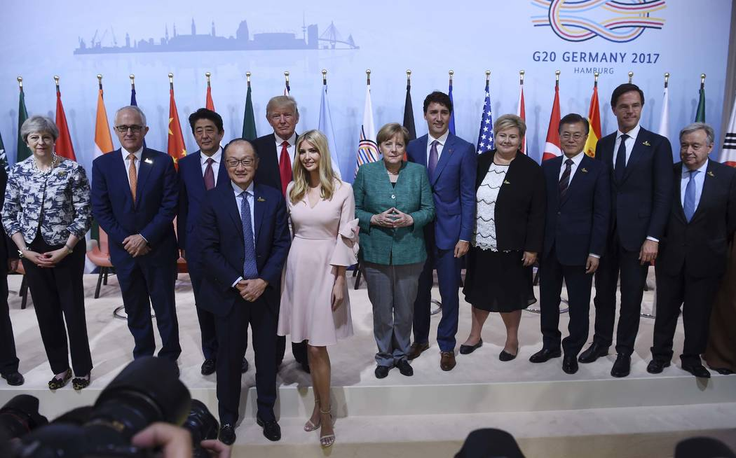 Participants among them the daughter of the US President Ivanka Trump, front right,  and World Bank Group President Jim Yong Kim, front left, and second row from left: , Britain's Prime Minister T ...