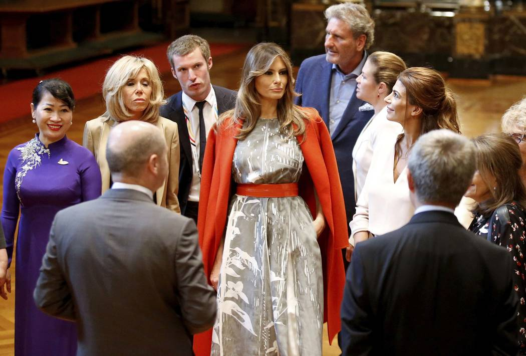 U.S. First Lady Melania Trump stands alongside other spouses during a G-20 leaders spouses event at the town hall during the G20 summit in Hamburg, Germany, Saturday,  July 8, 2017.  (Axel Schmidt ...