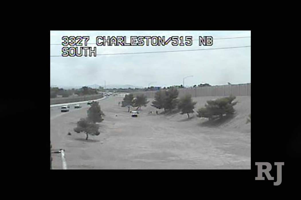 A traffic cam photo from just before 1 p.m. on Saturday appears to show a police vehicle in a desert area near an off on-ramp to U.S. Highway 95 at Charleston Boulevard. Las Vegas police and Nevad ...