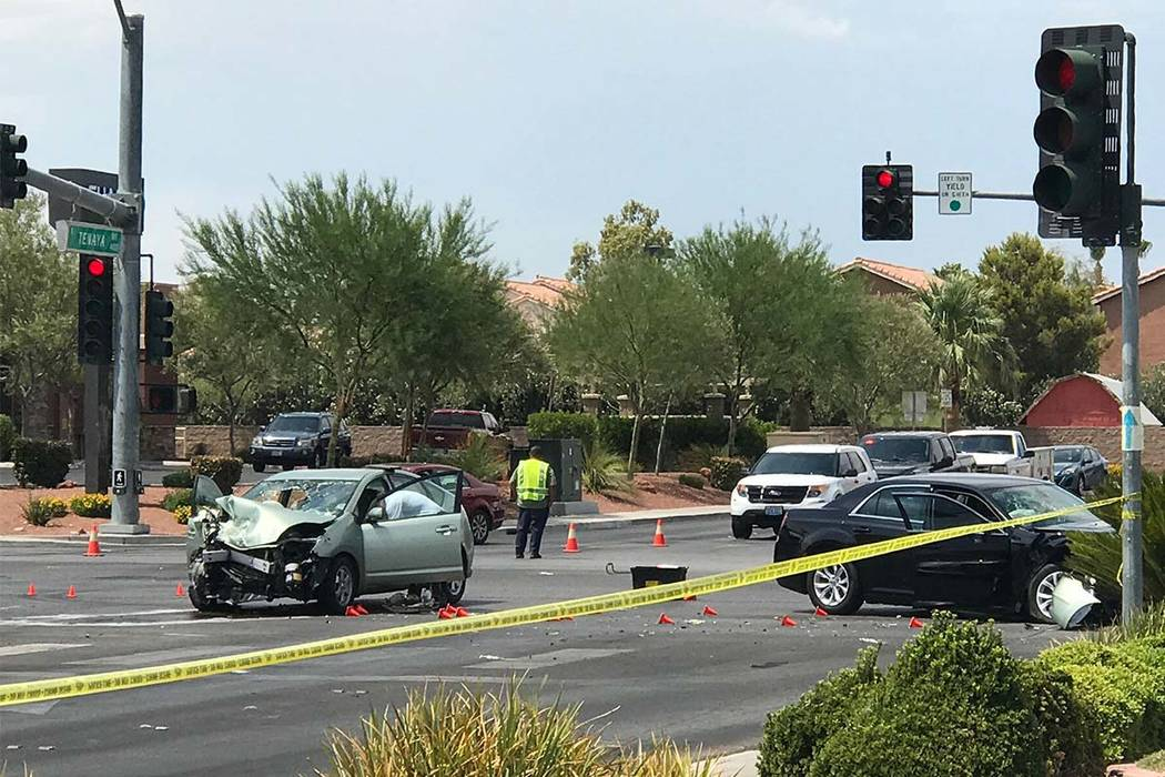 Las Vegas police work at the scene of a fatal accident Saturday at the intersection of Craig Road and Tenaya Way in the northwest valley. Blake Apgar Las Vegas Review-Journal