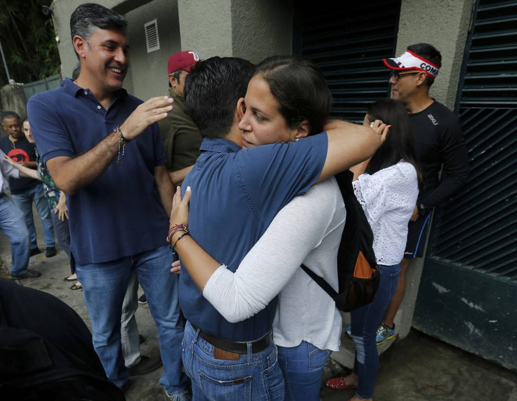 Supporters of opposition leader Leopoldo Lopez celebrate outside his home in Caracas, Venezuela, Saturday, July 8, 2017.  Lopez has been transferred to house arrest. The court says in a statement  ...