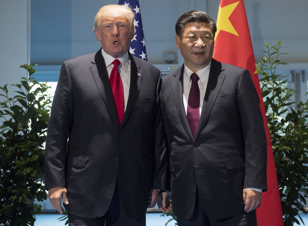US President Donald Trump and Chinese President Xi Jinping, right, arrive for a meeting on the sidelines of the G-20 Summit in Hamburg, Germany, Saturday, July 8, 2017.  (Saul Loeb/Pool Photo via AP)