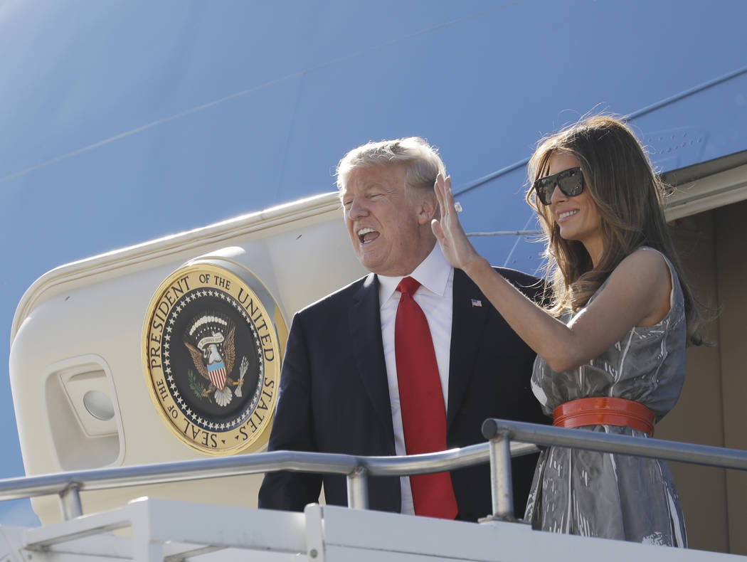 First lady Melania Trump waves as she and President Donald Trump board Air Force One in Hamburg, Germany, Saturday, July 8, 2017, as they travel to Washington following the G20 Summit.  (AP Photo/ ...