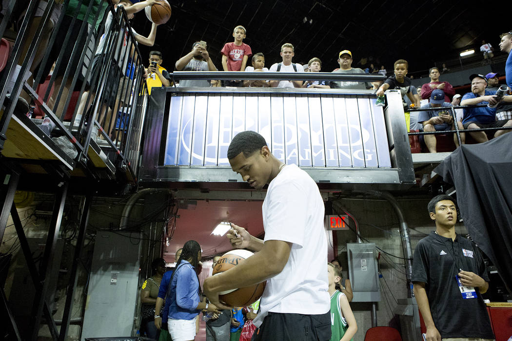 Los Angles Lakers' Jordan Clarkson sings things for fans after his NBA Summer League game against the Boston Celtics on Saturday, July 8, 2017.The Lakers versus Celtics game is the first sol ...