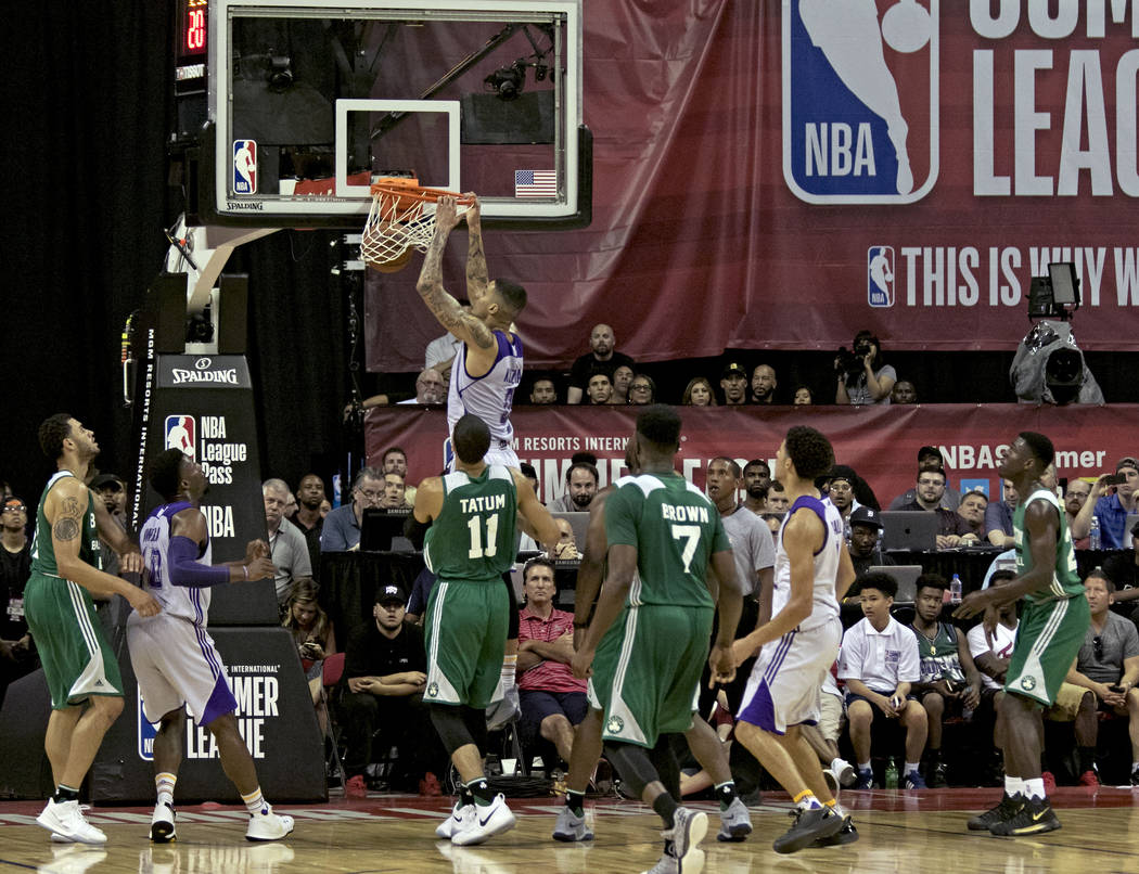 Los Angeles Lakers forward Kyle Kuzma (0) scores a slam dunk during the Lakers NBA Summer League game against the Boston Celtics at Thomas and Mack Center in Las Vegas on Saturday, July 8, 2017. G ...