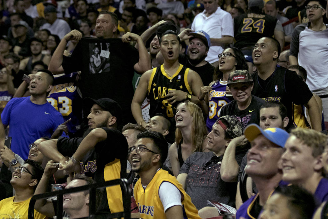 Los Angeles Lakers fans mug for the camera during the Lakers NBA Summer League game against the Boston Celtics at Thomas and Mack Center in Las Vegas on Saturday, July 8, 2017. Gabriella Benavidez ...