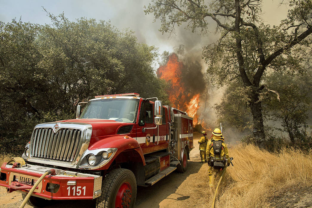 Firefighters battle a wildfire near Oroville, Calif., on Saturday, July 8, 2017. (AP Photo/Noah Berger)