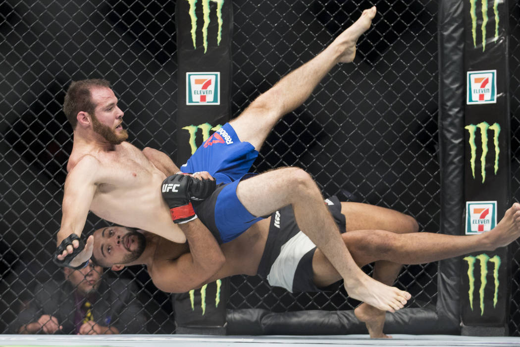 James Bochnovic, top, as he is dropped by Trevin Giles in the UFC 213 light heavyweight bout at T-Mobile Arena in Las Vegas, Saturday, July 8, 2017. Giles won by knockout. Erik Verduzco Las Vegas  ...