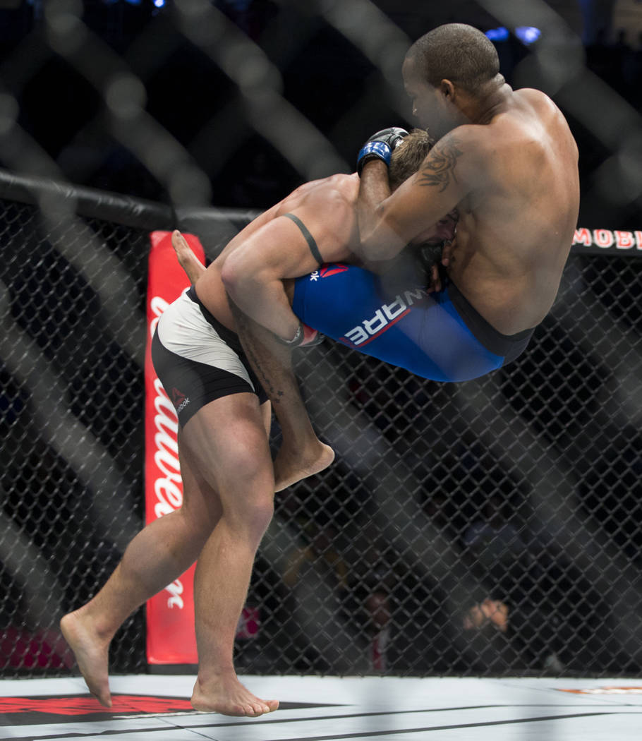 Cody Stamann, left, as he drops Terrion Ware in the UFC 213 featherweight bout at T-Mobile Arena in Las Vegas, Saturday, July 8, 2017. Stamann won by unanimous decision. Erik Verduzco Las Vegas Re ...
