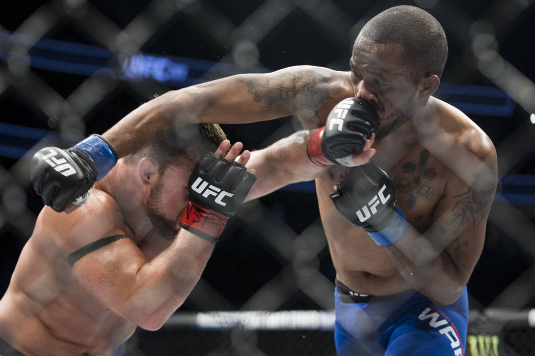 Cody Stamann, left, battles Terrion Ware in the UFC 213 featherweight bout at T-Mobile Arena in Las Vegas, Saturday, July 8, 2017. Stamann won by unanimous decision. Erik Verduzco Las Vegas Review ...