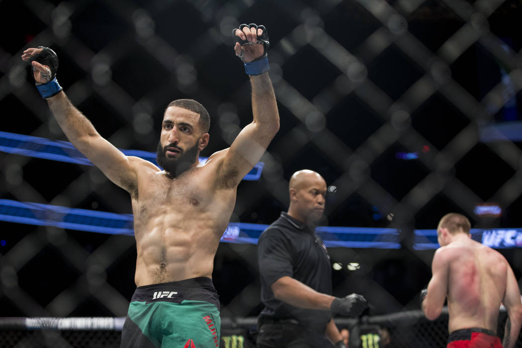 Belal Muhammad, left, at the end of his fight against Jordan Mein in the UFC 213 welterweight bout at T-Mobile Arena in Las Vegas, Saturday, July 8, 2017. Muhammad won by unanimous decision. Erik  ...