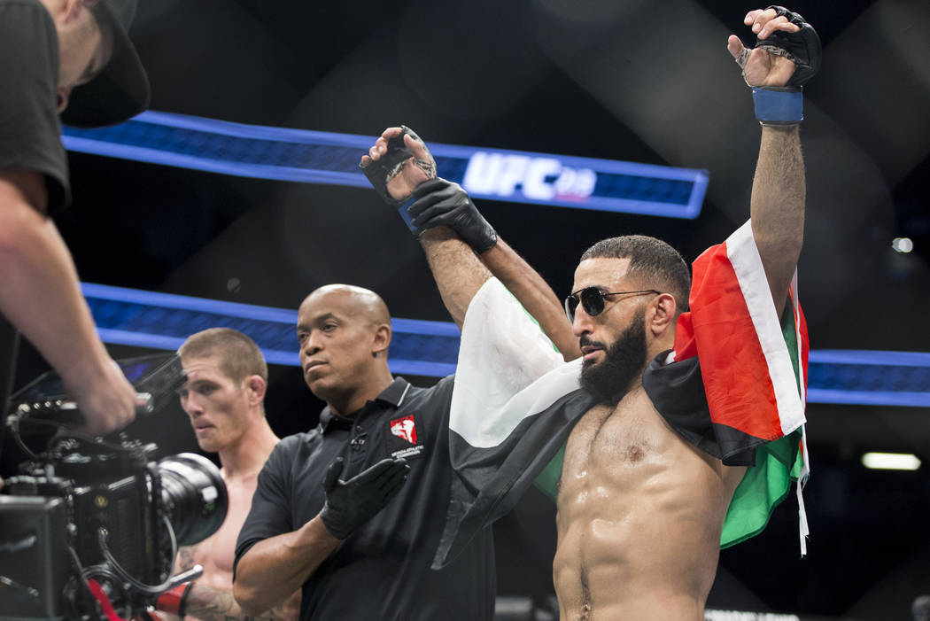 Belal Muhammad, right, is announced the winner against Jordan Mein in the UFC 213 welterweight bout at T-Mobile Arena in Las Vegas, Saturday, July 8, 2017. Muhammad won by unanimous decision. Erik ...